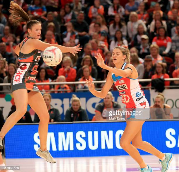 Susan Petitt of the Giants and Sophie Garbin of the Swifts compete for the ball during the round three Super Netball match between the NSW Swifts and...