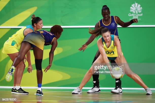 Susan Pettitt of Australia collects the ball during the Netball Preliminary Round Pool A match between Australia and Barbados on day two of the Gold...