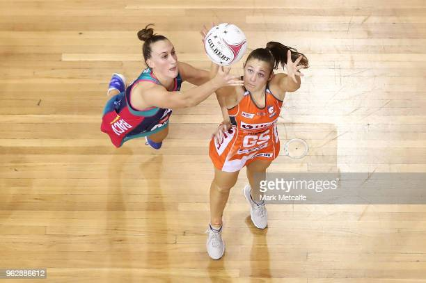 Susan Pettitt of the Giants and Emily Mannix of the Vixens compete for the ball during the round five Super Netball match between the Giants and the...