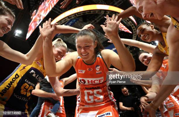 Susan Pettitt of the Giants runs through a guard of honour after announing her retirement during the Super Netball Preliminary Final match between...