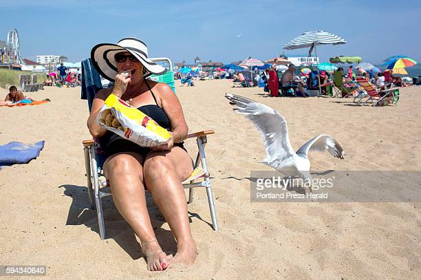 Susan Rencourt, from St. Georges in Quebec, soaks up some sun on the beach. Rancourt as been coming to Old Orchard Beach for summer vacation for...