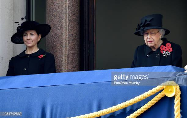 Susan Rhodes and Queen Elizabeth II watch from a balcony of The Foreign Commonwealth Development Office during the National Service of Remembrance at...