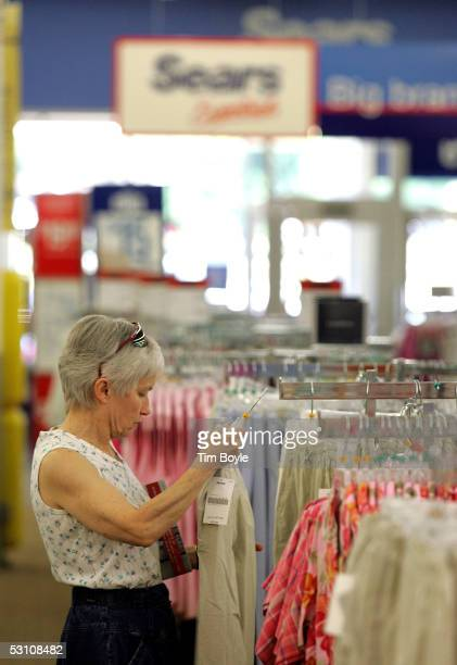 Susan Riley shops for women's clothing in a newly opened Sears Essentials store June 20 2005 in Palatine Illinois This Sears Essentials a remodeled...