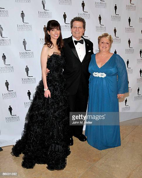 Susan Rosen Lynch Patrick Wayne and Marissa Coughlan attend the 24th Annual Odyssey Ball at the Beverly Hilton Hotel on April 18 2009 in Beverly...