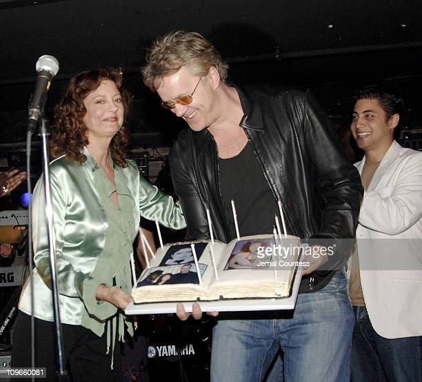 Susan Sarandon and Tim Robbins as Susan is honored with a birthday cake commemerating her actual birthday
