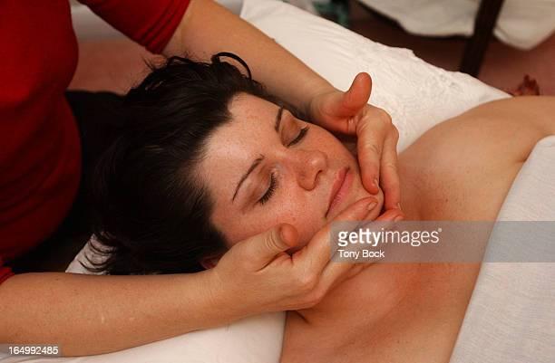 Susan Shaw who has fibromyalgia receives a massage from Nancy Ranalli