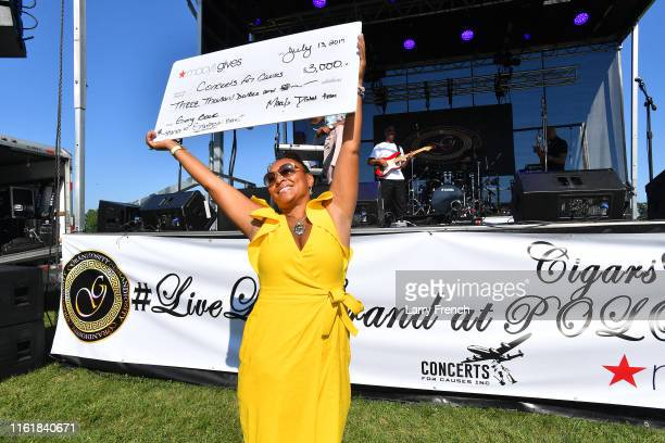 Susan Smallwood is seen during the Macy's check presentation at Grandiosity Events CigarsGuitars Charity PoloJazz charity event Powered by Logical...