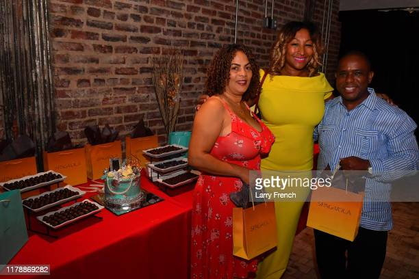 Susan Smallwood of Grandiosity Events is seen with Crisoire Reid and Eric Reid of Spagnvola Chocolatier at Jamie Foster Brown's Sister2Sister DC...