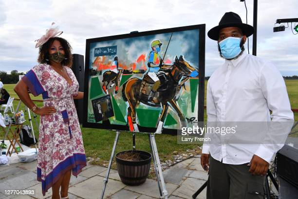 Susan Smallwood, producer of Grandiosity Events Cigars & Guitars Charity Polo & Jazz charity event and Demont Pinder, artist and historian are seen...