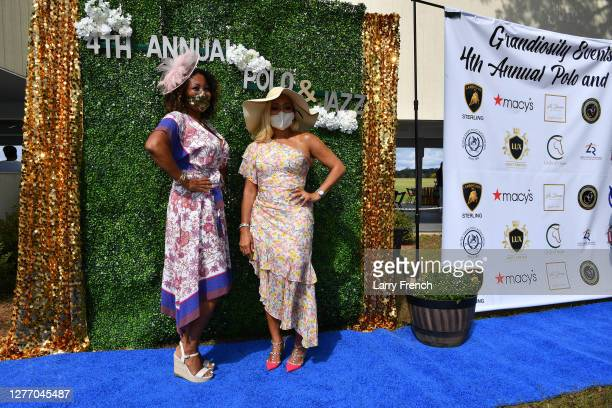Susan Smallwood, producer of Grandiosity Events Cigars & Guitars Charity Polo & Jazz charity event, and Karen Huger of Housewives of Potomac and...