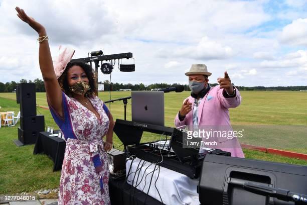 Susan Smallwood, producer of Grandiosity Events Cigars & Guitars Charity Polo & Jazz charity event and DJ V appear at Grandiosity Events 4th annual...