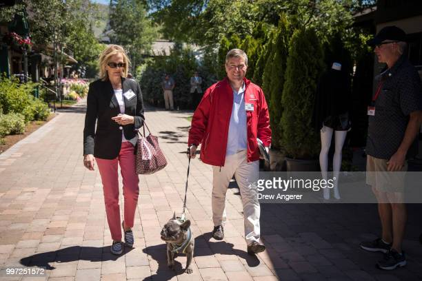 Susan Tolson and husband Charles Rivkin chairman and chief executive officer of Motion Picture Association of America walk with their dog at the...