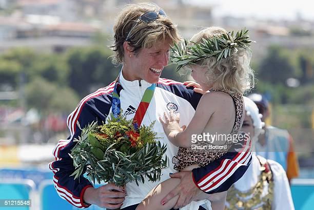 Susan Williams of the United States smiles at her daugter, Sydney, after she receives the bronze medal during ceremonies for the women's triathlon on...