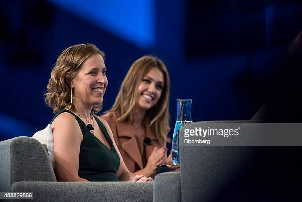 Susan Wojcicki chief executive officer of YouTube Inc left and Actress Jessica Alba cofounder of The Honest Co have a laugh during the DreamForce...