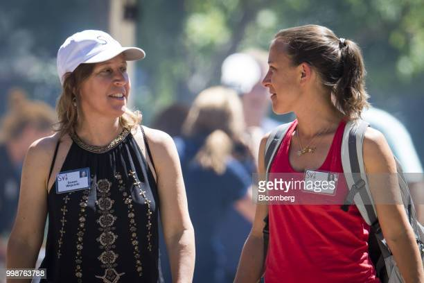 Susan Wojcicki chief executive officer of YouTube Inc left and Anne Wojcicki chief executive officer and cofounder of 23andMe Inc walk the grounds...
