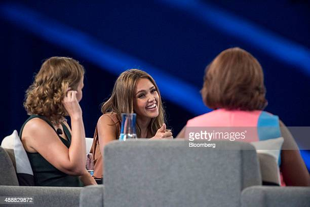 Susan Wojcicki chief executive officer of YouTube Inc left listens as Actress Jessica Alba cofounder of The Honest Co center speaks during the...