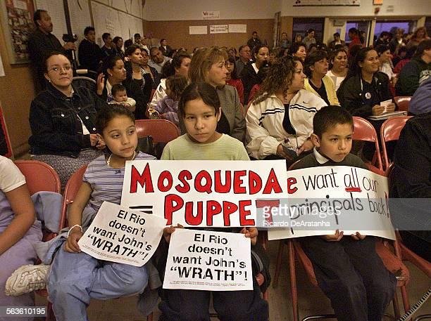 Susana Morelos Vanessa Morelos 13 and Adrian Castillon all from Rio Del Valle school holding up protest signs at the Rio School District board...