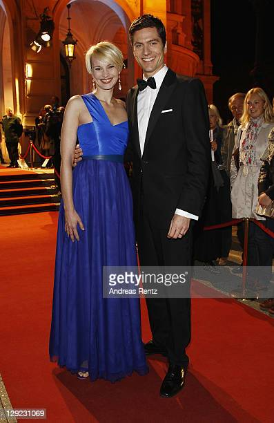Susann Atwell and Ingo Zamperoni attend the 22nd Hesse Movie Award at Alte Oper on October 14 2011 in Frankfurt am Main Germany