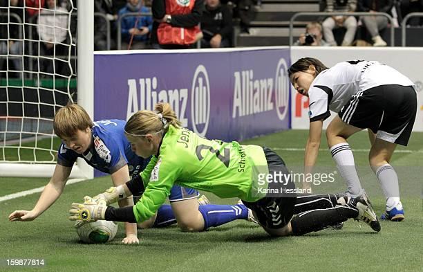 Susann Utes and Goalkeeper Katja Schroffenegger of FF USV Jena save the ball as Saki Kumagai of 1FFC Frankfurt makes a challenge during the DFB...