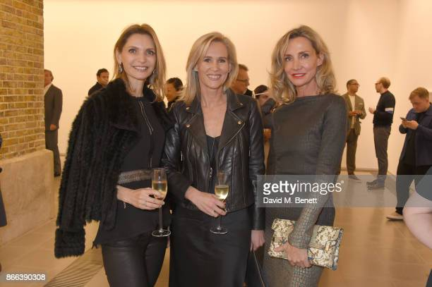 Susanna Abu Zalaf Tia Graham and Marie Moatti attend the Cerruti 1881 50th anniversary film premiere at The Serpentine Sackler Gallery on October 25...