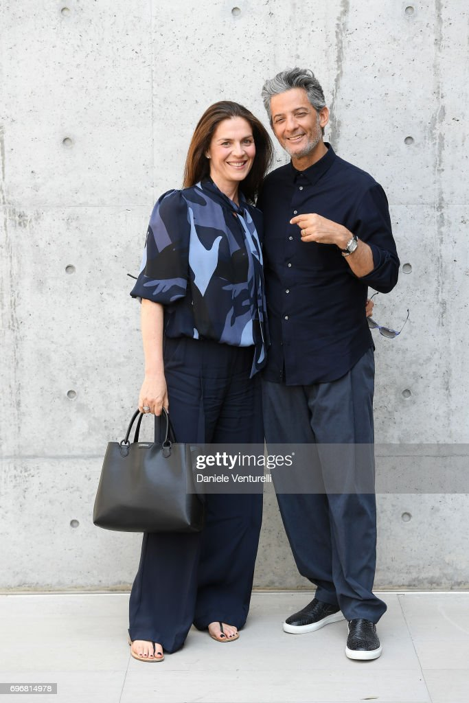 Susanna Biondo and Rosario Fiorello attend the Emporio Armani show during Milan Men's Fashion Week Spring/Summer 2018 on June 17, 2017 in Milan, Italy.