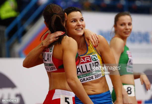 Susanna Kallur of Sweden hugs Alina Talay of Belarus after both qualify for the final during the Women's 60 metres hurdles semi finals on day one of...