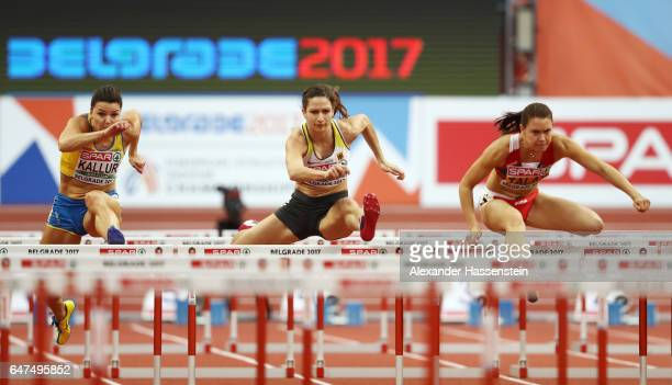 Susanna Kallur of Sweden Ricarda Lobe of Germany and Alina Talay of Belarus compete in the Women's 60 metres hurdles semi finals on day one of the...