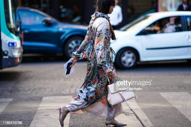 Susanna Lau wears a floral print multicolor dress a Valentino bag outside Valentino during Paris Fashion Week Haute Couture Fall/Winter 2019/2020 on...