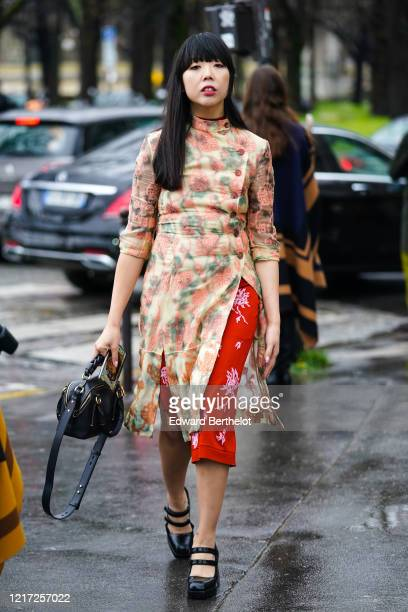 Susanna Lau wears a pink and green floral print dress, a red skirt, a black leather bag, black shiny shoes, outside Chloe, during Paris Fashion Week...