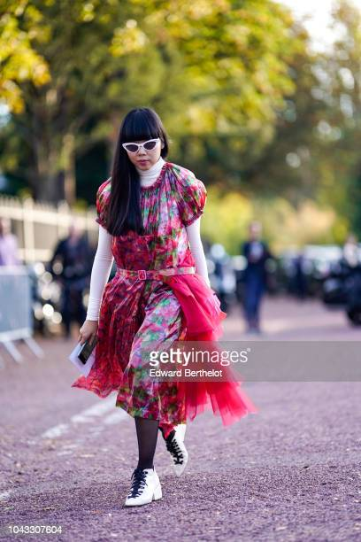 Susanna Lau wears sunglasses a red floral print dress with lace ruffle white shoes outside Hermes during Paris Fashion Week Womenswear Spring/Summer...