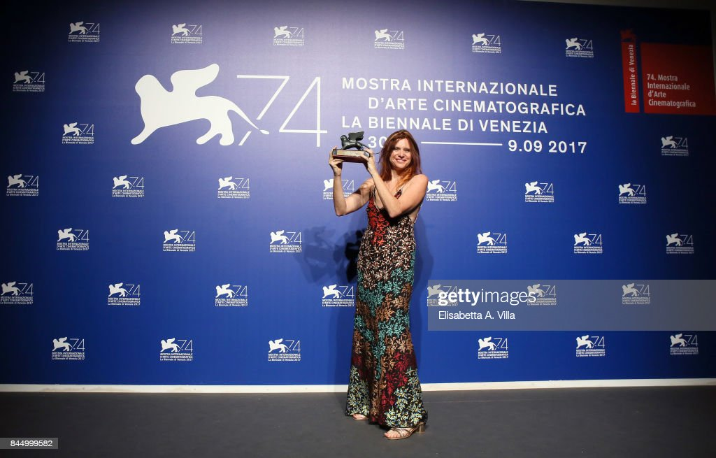 Susanna Nicciarelli poses with theOrizzonti Award for Best Film for 'Nico, 1988' at the Award Winners photocall during the 74th Venice Film Festival at Sala Casino on September 9, 2017 in Venice, Italy.