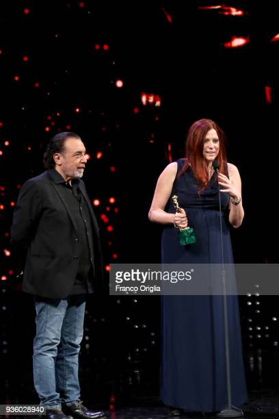 Susanna Nicchiarelli receives Best Original Screenplay Award from Nino Frassica during the 62nd David Di Donatello awards ceremony on March 21 2018...