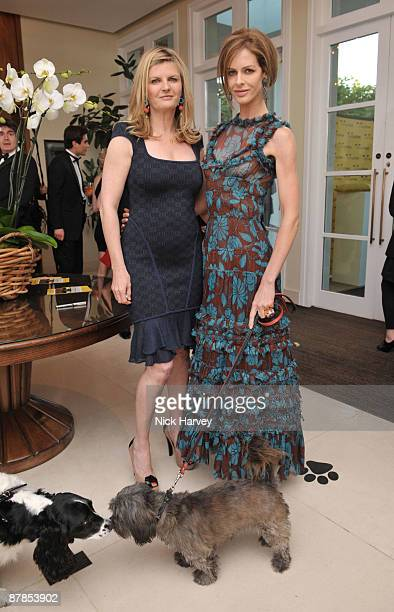 Susannah Constantine and Trinny Woodall with Poppy the dog attend the Dogs Trust Honours 2009 at The Hurlingham Club on May 19 2009 in London England
