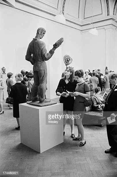 Susannah Gilmore and Patricia Williams viewing a sculpture by Austrianborn artist Siegfried Charoux entitled 'Reader' at the private view of the the...