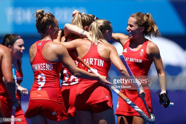 Susannah Townsend, Hannah Martin, Shona McCallin and Lily Owsley of Team Great Britain celebrate their first goal scored by Elena Sian Rayer during...