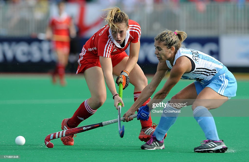Susannah Townsend of England and Ana Perez Rodriguez of Argentina battle for the ball during the Investec Hockey World League - Semi Finals match between Argentina and England at The University of Westminster Sports Ground on June 29, 2013 in London, England.