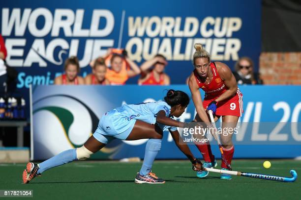 Susannah Townsend of England and Namita Toppo of India battle for possession during the Quarter Final match between England and India during the FIH...