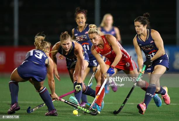 Susannah Townsend of England battles with Ashley Hoffman and Michelle Vittese of United States of America during day 7 of the FIH Hockey World League...