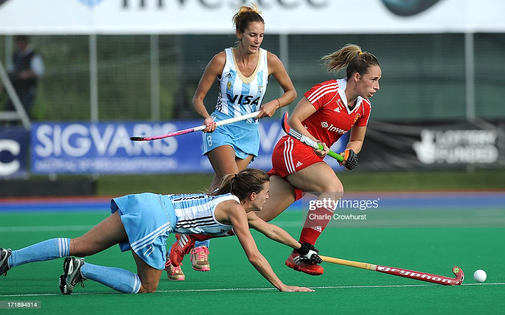 Susannah Townsend of England gets past Carla Rebecchi of Argentina during the Investec Hockey World League - Semi Finals match between Argentina and England at The University of Westminster Sports Ground on June 29, 2013 in London, England.