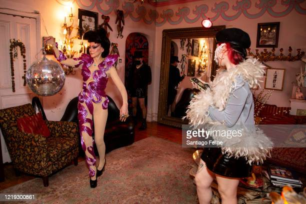 Susanne Bartsch and Caroline Caldwell do a twirl at home while hosting Susanne Bartsch's 'ONTOP' ONLINE via ZOOM on April 16 2020 in New York City