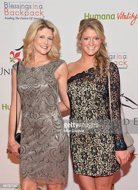 Susanne Blackinton and guest attend the 2014 Unbridled Eve Derby Gala during the 140th Kentucky Derby at Galt House Hotel Suites on May 2 2014 in...
