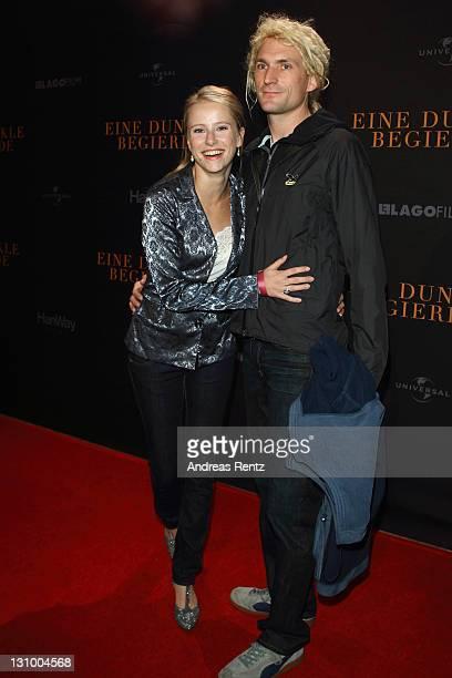Susanne Bormann and partner attend 'Eine Dunkle Begierde' photocall at Astor Film Lounge on October 31 2011 in Berlin Germany