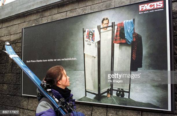 Susanne Lin aged 30 from the USA studies the Prince of Wales lookalike featured in a giant poster near one of the skiing Royal's favourite slopes in...