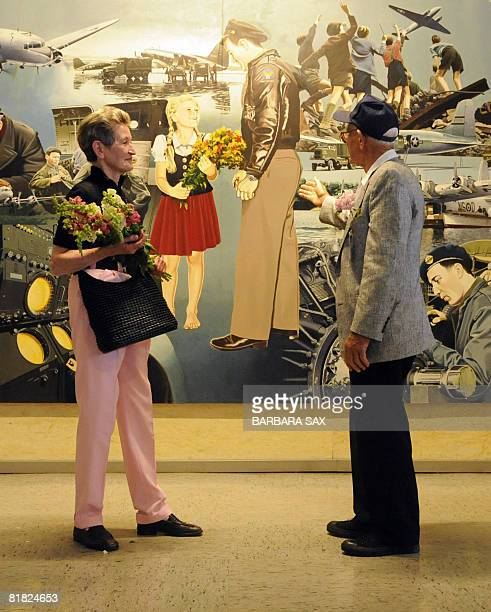 Susanne Riedi-Joks and former US Air Force pilot Donald W. Measley look at a picture painted after a photograph that was taken during the Berlin...