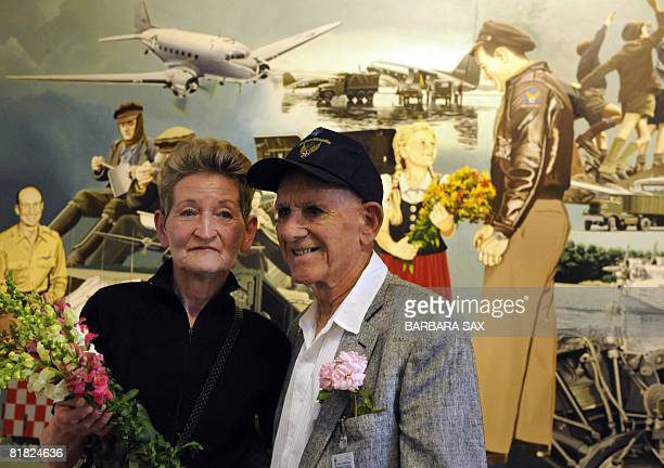 Susanne Riedi-Joks and former US Air Force pilot Donald W. Measley pose in front of a picture painted after a photograph that was taken during the...