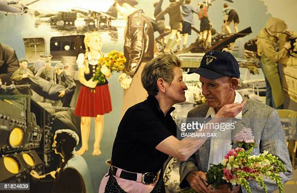 Susanne Riedi-Joks hugs former US Air Force pilot Donald W. Measley in front of a picture painted after a photograph that was taken during the Berlin...