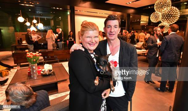 Susanne Soellner Tom Fritsch pose with dog Ludwig during the BB Italia store event on May 11 2017 in Munich Germany