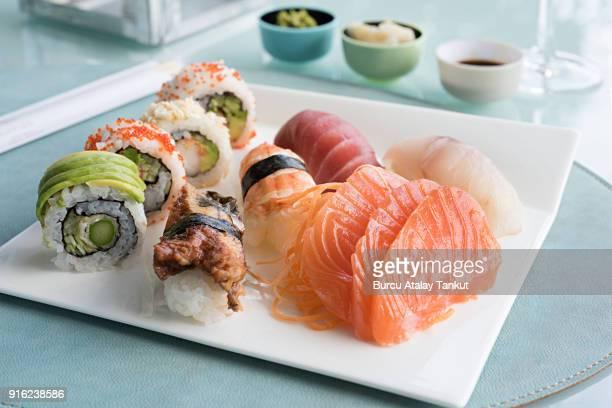 sushi and sashimi plate - sashimi stock photos and pictures