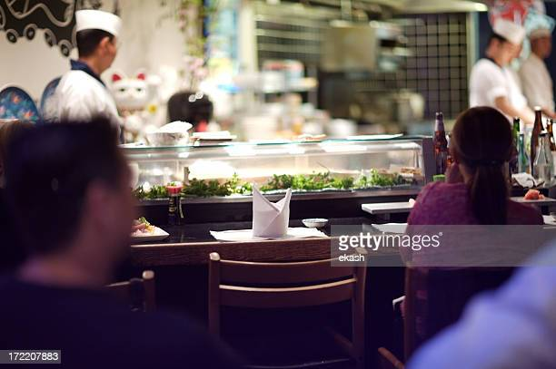sushi bar - sushi restaurant stock photos and pictures