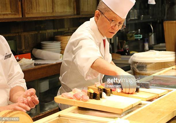 sushi chef at tsukiji - sushi restaurant stock photos and pictures